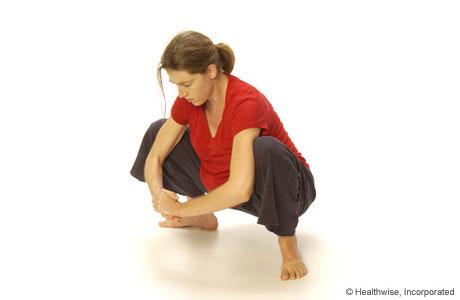 A woman squatting