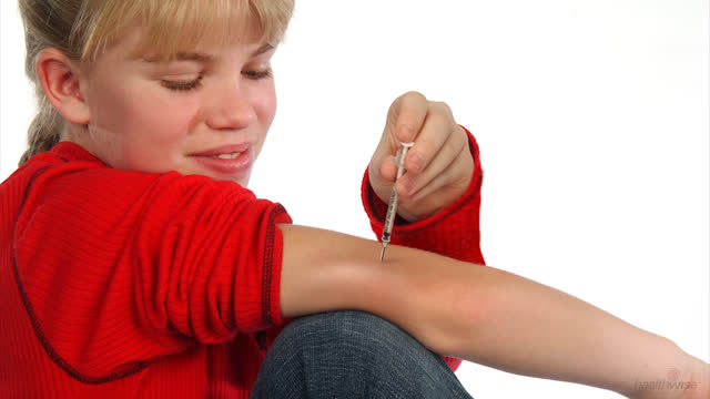 Insulin: Giving an Injection in the Arm Using a Syringe