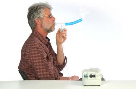A man using a nebulizer