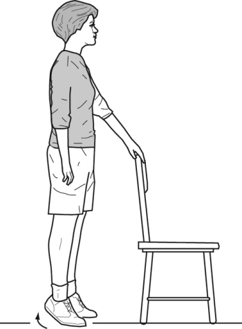 woman standing next to chair raising heels