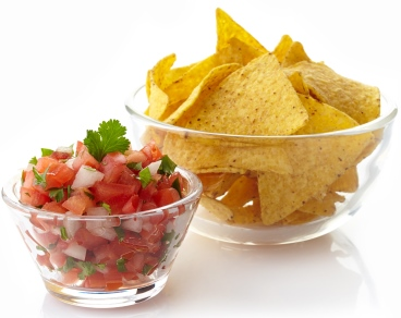 Bowl of chips next to bowl of salsa
