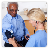 Picture of a man having his blood pressure checked