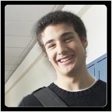 Photo of a teenage boy standing in a school hallway