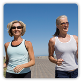 Photo of two women running outside